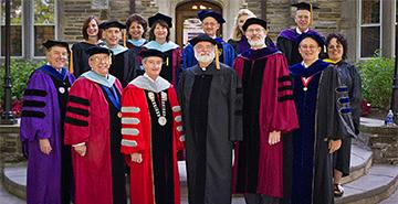 A group of Columbia University faculty at commencement.